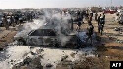 Hiện trường sau một vụ đánh bom tự sát bên ngoài thành phố thiêng Karbala của người Shia ở miền nam Iraq, ngày 20/1/2011