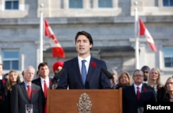 FILE - Canadian Prime Minister Justin Trudeau speaks to the crowds in Ottawa, Nov. 4, 2015.