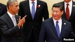 Le président Barack Obama (à g.) et son homologue chinois Xi Jinping (Reuters)