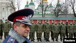"Members of the newly created Ukrainian interior ministry battalion ""Saint Maria"" take part in a ceremony before heading to military training, in front of St. Sophia Cathedral, in Kyiv, Feb. 3, 2015."