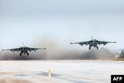 FILE - FILE - A handout picture taken on March 16, 2016, and released by the Russian Defense Ministry shows Russian Sukhoi Su-25 ground attack aircraft taking off from the Hmeimim military base in Latakia province, Syria.