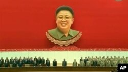 North Korean leader Kim Jong Un, center, attends an event to mark the second anniversary of the death of his father, former leader Kim Jong Il, in Pyongyang, North Korea, Dec. 17, 2013.