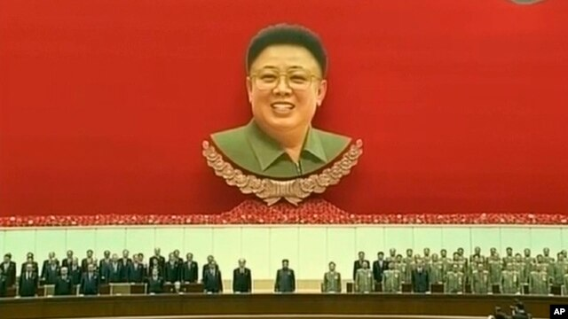 orth Korean leader Kim Jong Un, center, attends an event to mark the second anniversary of the death of his father, former leader Kim Jong Il, in Pyongyang, North Korea Tuesday, Dec. 17, 2013.