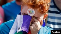 FILE - A same-sex marriage supporter reacts at Dublin Castle in Dublin, Ireland, May 23, 2015.