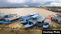 Boats for taking tourists to nearby Tonle Sap lake anchor inside Sou Jing Company development site in Siem Reap province, August 11, 2021. (Photo provided by So Rosa)