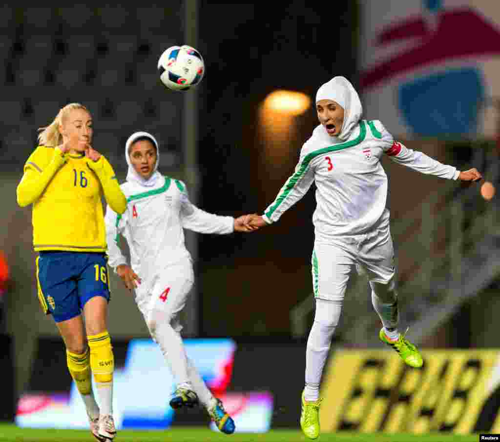 Iran's Koueistan Khosravi heads the ball in front of Sweden's Petra Andersson during the international friendly soccer match between Sweden and Iran at the Old Ullevi Soccer Stadium in Gothenborg, Sweden.