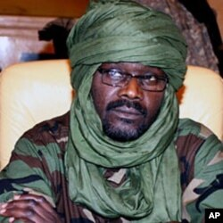 A 2009 file photo of Sudanese rebel Justice and Equality Movement (JEM) leader Khalil Ibrahim during a Darfur peace meeting in Doha, Qatar. He is currently living in Libya's capital, Tripoli.