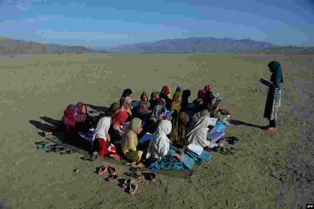 Afghan school children attend an open-air school at the Gambiri Refugee Camp in Laghman province.