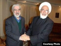 Mir Hüseyn Musəvi (sol) və Mehdi Kərrubi