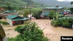 Cenário de cheias, Vietnam (Vietnam Red Cross/Ta Hong Long/Handout via Reuters)