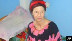 British hostage Judith Tebbutt, is pictured at a house in Adado, central Somalia, before her departure, March 21, 2012.