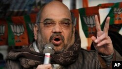 India's ruling Bharatiya Janata Party (BJP) President Amit Shah addresses an election rally in Srinagar, Indian controlled Kashmir, Dec. 11, 2014.