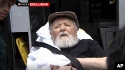 FILE - Jakiw Palij, a former Nazi concentration camp guard, is carried on a stretcher from his home in the Queens borough of New York, Aug. 20, 2018, in this frame from video.