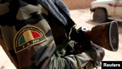 FILE - A Malian Armed Forces patch worn by a soldier is pictured during the regional anti-insurgent Operation Barkhane in Tin Hama, Mali, Oct. 19, 2017.