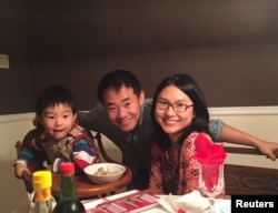 Xiyue Wang, a naturalized American citizen from China, arrested in Iran last August while researching Persian history for his doctoral thesis at Princeton University, is shown with his wife and son in this family photo.