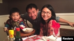Xiyue Wang, a naturalized American citizen from China, arrested in Iran last August while researching Persian history for his doctoral thesis at Princeton University, is shown with his wife and son in this family photo released in Princeton, New Jersey, U.S. on July 18, 2017.