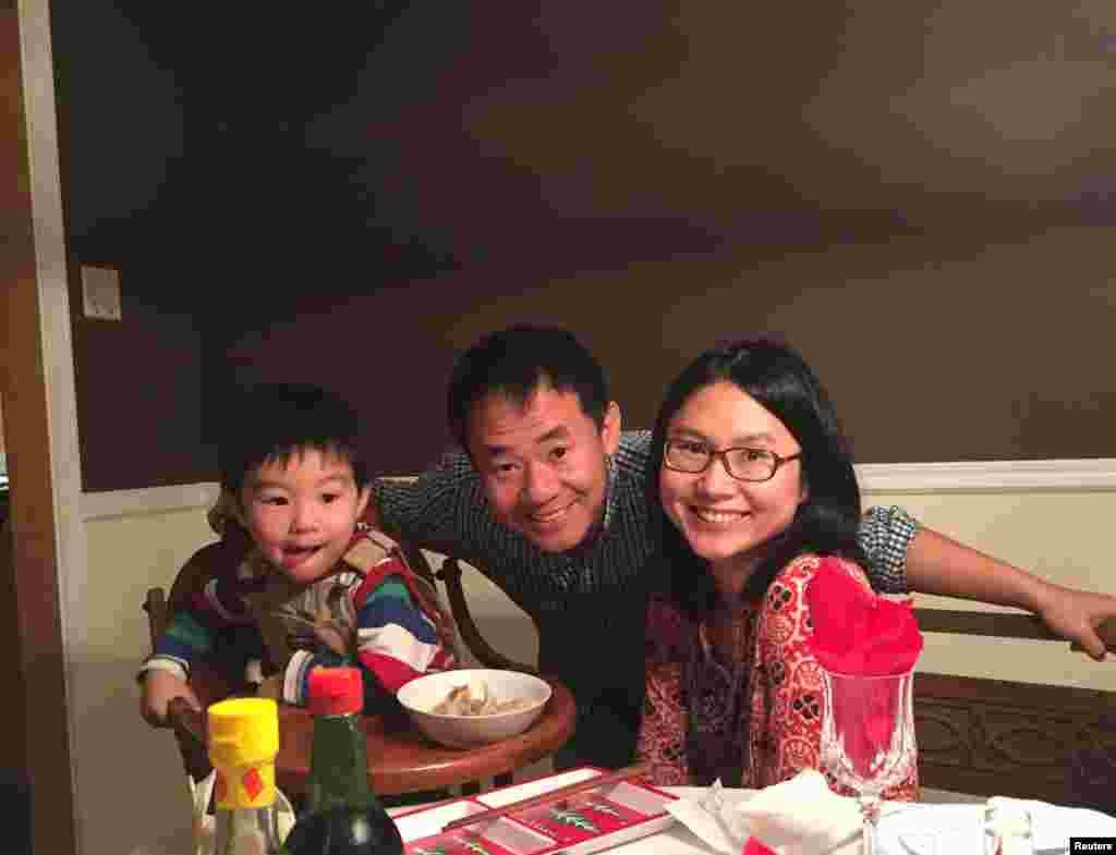 Xiyue Wang, a naturalized American citizen from China who was arrested in Iran in August 2016 while researching his doctoral thesis at Princeton University, is shown with his wife and son in in Princeton, N.J.
