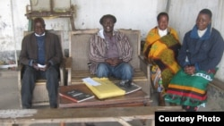 Somanje-Makata (second from left) sits at court in his Blantyre suburb with court advisers. (Photo by Lameck Masina)