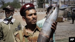 A defected army soldier shows an artillery shell allegedly fired by troops loyal to President Ali Abdullah Saleh in Sanaa, Yemen, October 27, 2011.