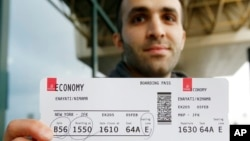 Just hours after an appeals court blocked an attempt to re-impose the travel ban, Iranian researcher Nima Enayati checked in on an Emirates Airline flight direct from Milan's Malpensa airport to New York's JFK, Feb. 5, 2017.