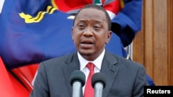 FILE - Kenyan President Uhuru Kenyatta, addresses a news conference at the State House in Nairobi, Dec. 2, 2014.