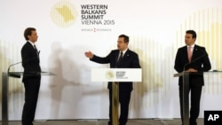 From left, Austrian Foreign Minister Sebastian Kurz, Serbian Foreign Minister Ivica Dacic and Macedonian Foreign Minister Nikola Poposki attend a news conference at the Western Balkans Summit in Vienna, Austria, Aug. 27, 2015.