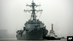 FILE - Guided missile destroyer USS Lassen arrives at the Shanghai International Passenger Quay in Shanghai, China, for a scheduled port visit.