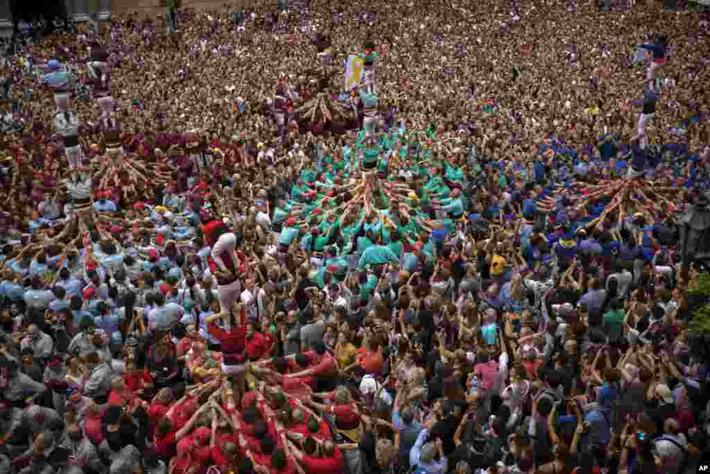 "Participants make human towers or ""Castellers"" during the Saint Merce celebrations in San Jaime square in Barcelona, Spain."