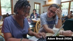 Mandisa Haarhoof reviews an essay with one of her undergraduate students.