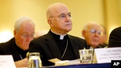 FILE - Archbishop Carlo Maria Vigano, Apostolic Nuncio to United States, listens to remarks at the United States Conference of Catholic Bishops' annual fall meeting in Baltimore, Maryland, Nov. 16, 2015.