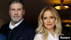 Kelly Preston et son mari John Travolta, 10 novembre 2018. L'actrice américaine est décédée le 12 juillet 2020 à l'âge de 57 ans. (REUTERS/Eric Gaillard)