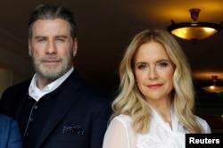 جان تراوولتا و همسرش «کلی پرستون» هنگام رونمائی فیلم «گاتی» در ۷۱ مین جشنواره سینمائی کن