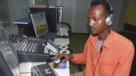 Hassan Yusuf monitors a computer in the control room during a live broadcast of the Somali government run radio.  Al-Shabab controls most of southern Somalia uses the Internet and radio stations to get its message out, FILE March 1, 2010.