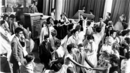 "Dick Clark, at upper left, is surrounded by teenage fans on his nationally televised dance show ""American Bandstand"" in 1958"