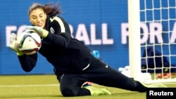 United States goalkeeper Hope Solo stops the ball during a training session for the Women's World Cup at Olympic Stadium, June 29, 2015.