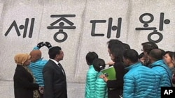 Cia Cia children visited downtown Seoul. The children know how to read hangul - which until recently was not a written language