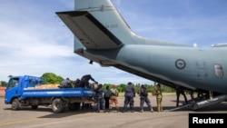 A supplied image of Australian Defence Force and Papua New Guinea Police Force personnel unloading ballot papers for the upcoming National Election, which runs from June 24 until July 8, from a C-27J Spartan aircraft in Papua New Guinea, June 15, 2017.