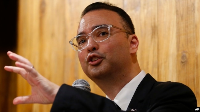 Philippine Foreign Affairs Secretary Alan Peter Cayetano gestures during a news conference on the South China Sea on Tuesday, Aug. 7, 2018, in suburban Taguig city east of Manila, Philippines. (AP Photo/Bullit Marquez)