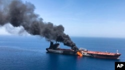 An oil tanker is on fire in the sea of Oman, Thursday, June 13, 2019. The incidents happened one month after four ships were damaged in the area, raising tensions between the United States and Iran. (AP Photo/ISNA)