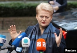 "FILE - Lithuania's President Dalia Grybauskaite tweeted a concise reaction to Britain's vote: ""Brexit: respect, regret, re-engage."""