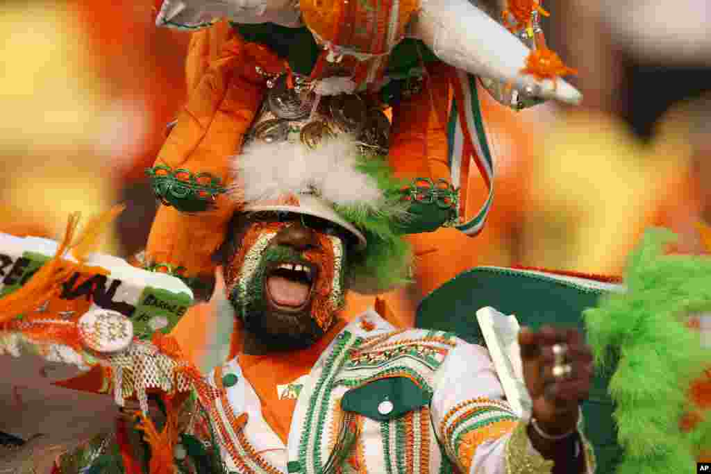 Ivory Coast fan cheers before the African Cup of Nations group D soccer match between Morocco and Ivory Coast in al Salam Stadium in Cairo, Egypt.