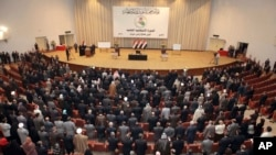 Iraqi lawmakers attend the parliament session in Baghdad, Iraq, Thursday, Nov. 11, 2010