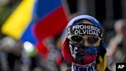 Opositores al gobierno de Nicolás Maduro protestaron durante el tercer aniversario de la represión contra una marcha de jóvenes que desató una ola de protestas en 2014.