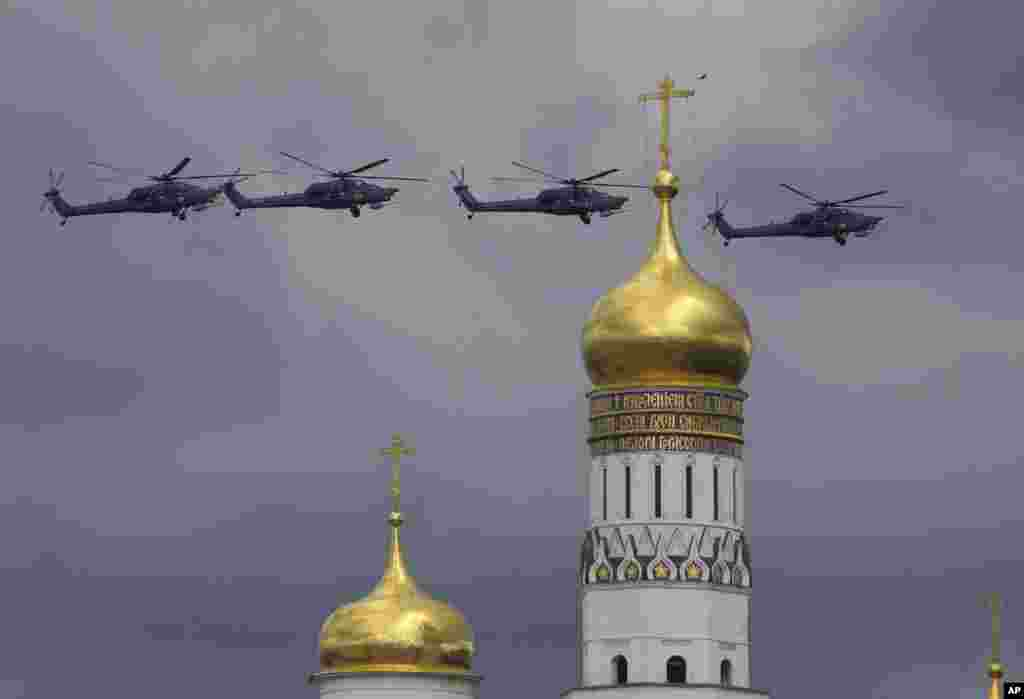 Russian military helicopters fly over Ivan the Great bell-tower and Moscow's Kremlin during a general rehearsal for the Victory Day military parade which will take place at Moscow's Red Square on May 9 to celebrate 71 years after the victory in WWII in Moscow, Russia,