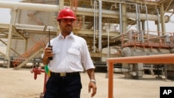 An Iranian worker in the partially constructed site which is part of South Pars gas field, in Assalouyeh, Iran, July 19, 2010. (AP Photo/Vahid Salemi)