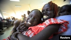 South Sudanese waiting to be flown back to their country sit at Khartoum Airport May 14, 2012.
