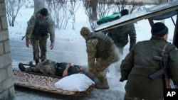 A Ukrainian soldier receives treatment in Avdiivka on January 31. Fighting between government forces and separatists supported by Russia has restarted although a ceasefire is in place.