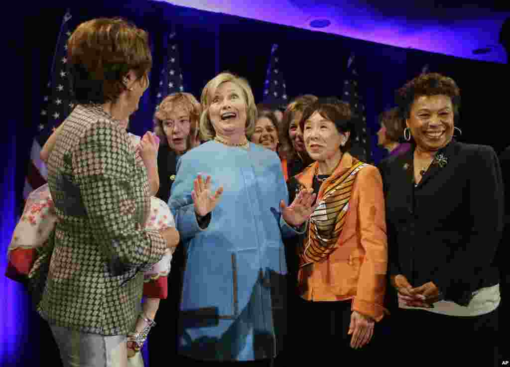 Former Secretary of State Hillary Rodham Clinton, center, gathers with House Minority Leader Nancy Pelosi, left, Rep. Zoe Lofgren, second from left, Rep. Doris Matsui, second from right, and Rep. Barbara Lee, right, for a photo after speaking at a fundrai