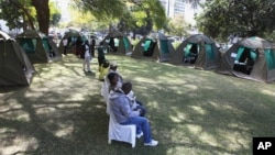 Members of the public wait to be tested for HIV and Aids in Harare, Zimbabwe, June, 22, 2012.