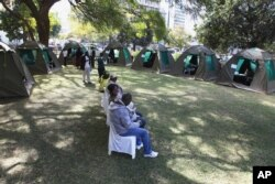FILE - Members of the public wait to be tested for HIV and AIDS in Harare, Zimbabwe, June, 22, 2012.